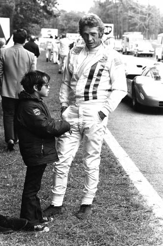 Steve McQueen relaxes with his son Chad as he stars in the movie 'Le Mans' on June 24
