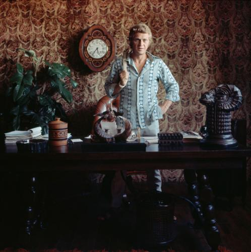 At home with Steve McQueen. Photograph by Milton H. Greene. Late 1960s.