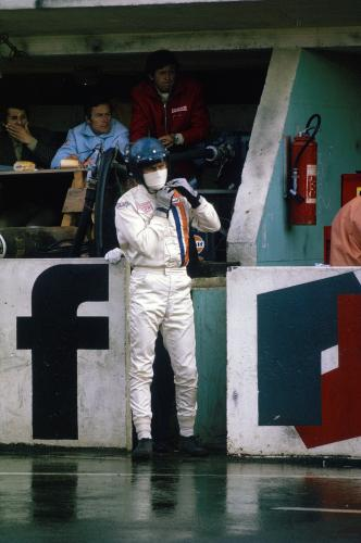 Steve McQueen in racing overalls at the race track at Le Mans