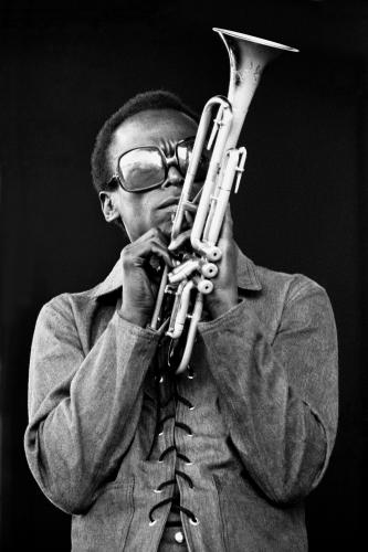 Miles Davis photographed on stage at Newport.