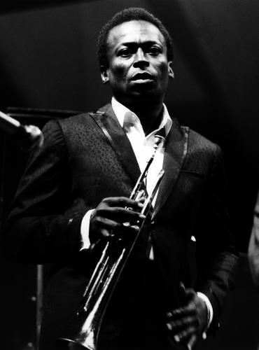 Miles Davis performing live onstage at the Newport Jazz Festival