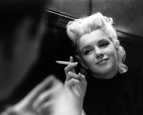 Marilyn Monroe relaxes in a quiet moment in a restaurant in New York City.