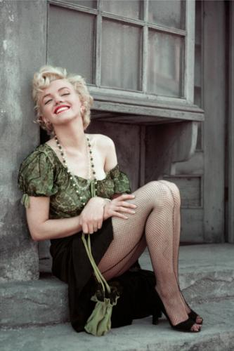 Marilyn Monroe playing the role of a streetwalker while on the back lots of 20th Century Fox in 1956. Marilyn is wearing the same blouse as her character ‰ÛÏCherie‰Û in the film Bus Stop.