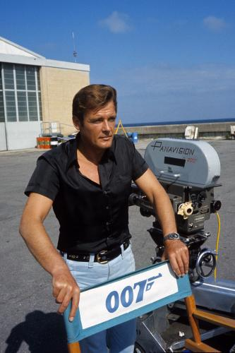 Roger Moore poses on location for the filming of James Bond film 'Live And Let Die'  in Kingston