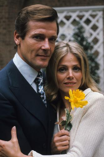Roger Moore and Britt Ekland pose on location for the filming of James Bond film 'The Man With The Golden Gun' in London