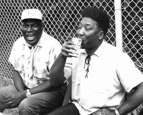 Howlin' Wolf & Muddy Waters photographed relaxing in 1969.