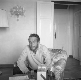 Actor Paul Newman relaxes with a bottle of Johnnie Walker