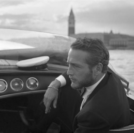 American actor Paul Newman during a trip on a water taxi with St Mark Square in the background