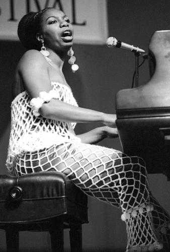 Nina SImone performing on stage at Newport