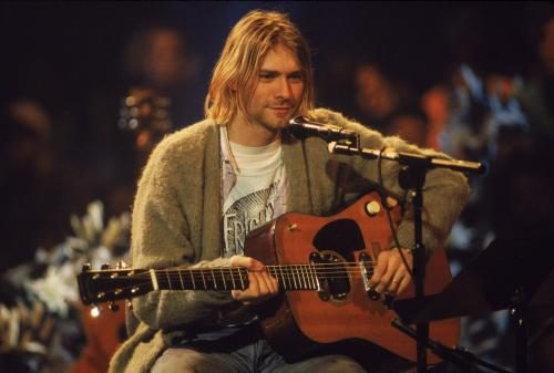 Kurt Cobain (1967 - 1994) performs with his group Nirvana at a taping of the television program 'MTV Unplugged