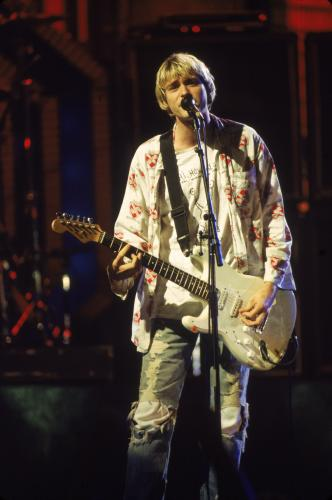 Rock singer Kurt Cobain (1967 - 1994) performs on stage with Nirvana at the MTV Video Music Awards