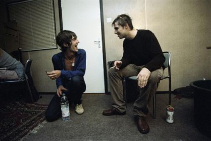 Richard Ashcroft and Liam Gallagher photographed backstage at Earls Court in 1997.
