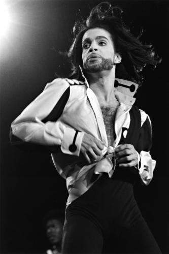 Prince performing on stage - Nude Tour
