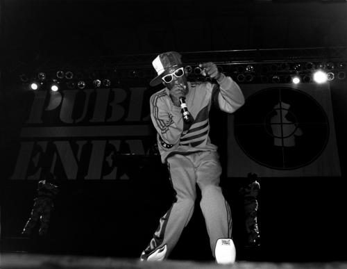 Flavor Flav of the rap group 'Public Enemy' performs onstage in February 1989 in Chicago