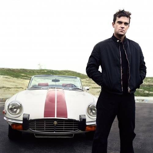 Robbie Williams posing in a sports car Sonic Editions print