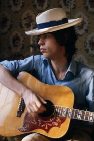 Mick Jagger of the Rolling Stones playing an acoustic guitar