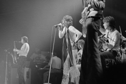 With microphone in hand, Mick Jagger sings to fans at the Montreal Forum, during a one-night show on the Stones' North American tour.