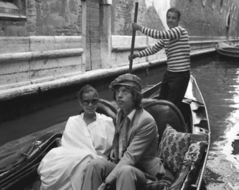 Mick Jagger sitting next to Bianca Jagger in a gondola, Venice 1971.