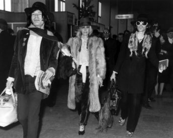 Rolling Stones lead singer Mick Jagger and the band's lead guitarist Keith Richards at London Airport with the German Actress Anita Pallenberg.