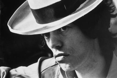 Mick Jagger of the Rolling Stones in a panama hat