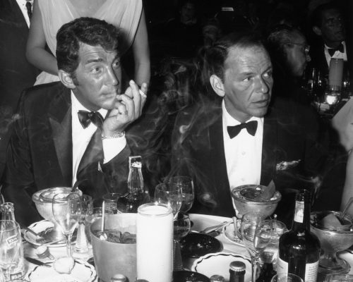 Dean Martin and Frank Sinatra attend the opening night performance of singer Eddie Fisher at the Coconut Grove, Hollywood, California. 1961.