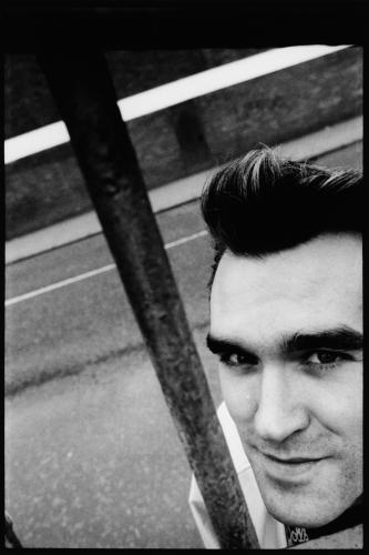 The Smiths lead singer Morrissey stands on the street in Salford