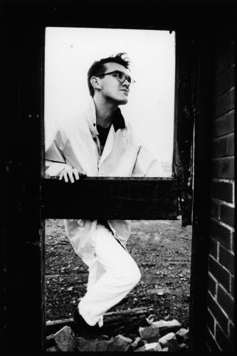 The Smiths lead singer Morrissey stands in the doorway of a derelict building