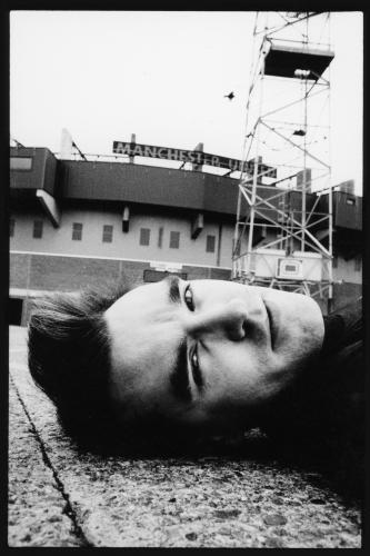 The Smiths lead singer Morrissey lies in front of Old Trafford