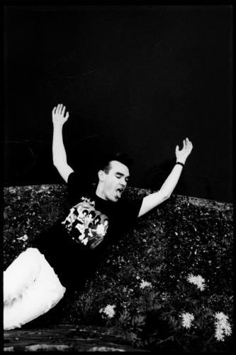 The Smiths lead singer Morrissey lies on the canal towpath in Salford wearing a New York Dolls T-Shirt. Greater Manchester