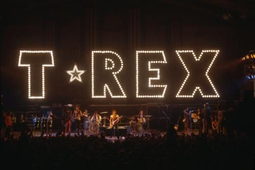 T-Rex perform with their name in lights above the stage