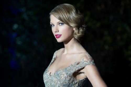 Taylor Swift attends The Winter Whites Gala In Aid Of Centrepoint at Kensington Palace on November 26