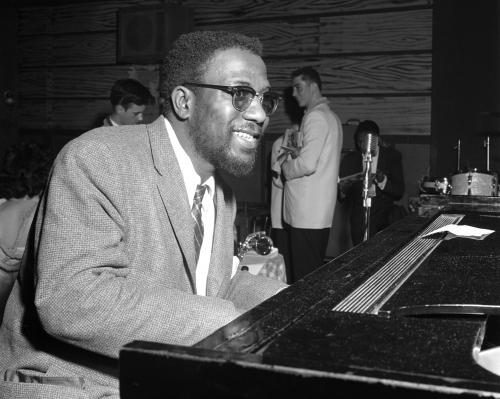 Jazz pianist Thelonious Monk performs at the Basin Street club.