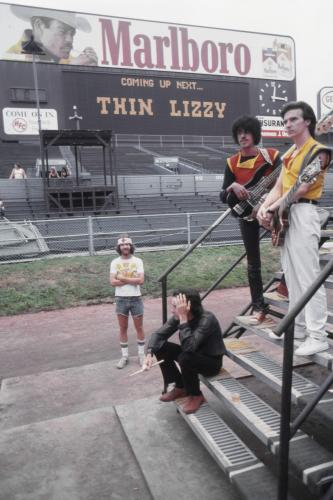 "Phil Lynott and other members of the rock and roll band ""Thin Lizzy"" backstage at the World Series of Rock concert at Cleveland Municipal Stadium."