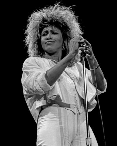 Tina Turner photographed on stage in 1985 by Janet Macoska.