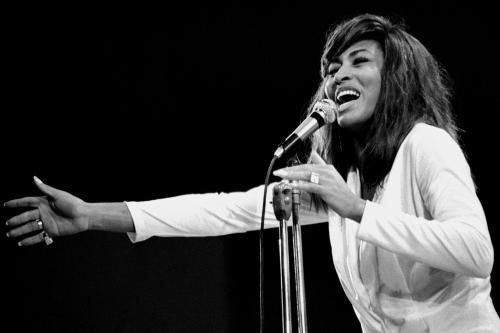Tina Turner photographed performing on stage at Newport.