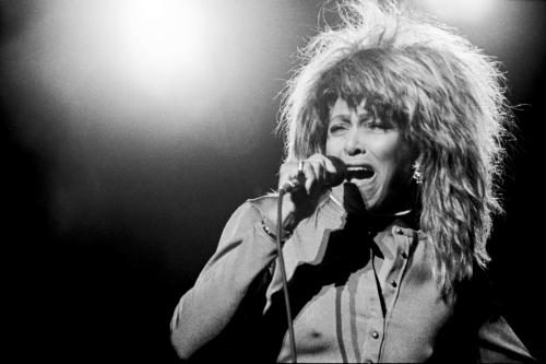 Tina Turner photographed on stage in 1987 by Janet Macoska.