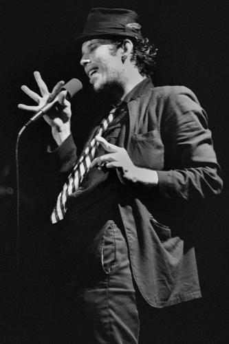 Tom Waits performing on stage in San Francisco.