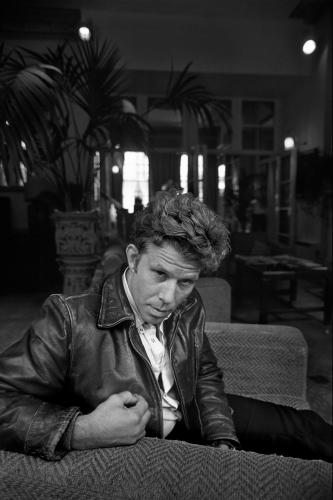 Tom Waits photographed relaxing in the lobby of the Portobello Hotel in London