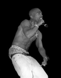Rapper and actor Tupac Shakur performs in September 1994 in Chicago