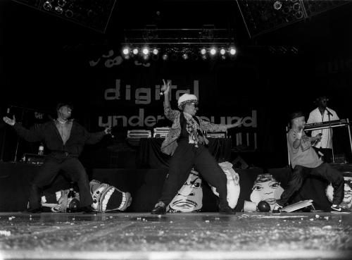 Digital Underground & Tupac performing on stage.