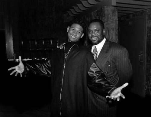 Singer Usher poses for photos with record executive L.A. Reid