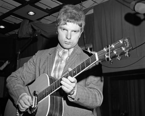 Musician Van Morrison plays a Martin acoustic guitar at a Bang Records recording session in the studio.