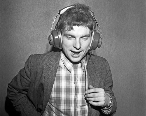 "Musician Van Morrison listens back through headphones at a Bang Records recording session in the studio for his 1st album ""Blowing Your Mind!"""