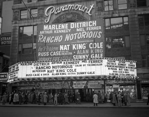 The Marquee of the Paramount Theatre at 43rd Street and Broadway in Times Square. The movie Rancho Notorious is playing as well as Nat 'King' Cole on May 15