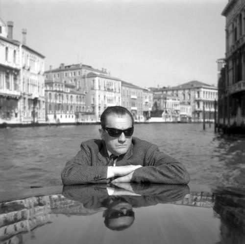 Italian director Luchino Visconti photographed on the Canal Grande