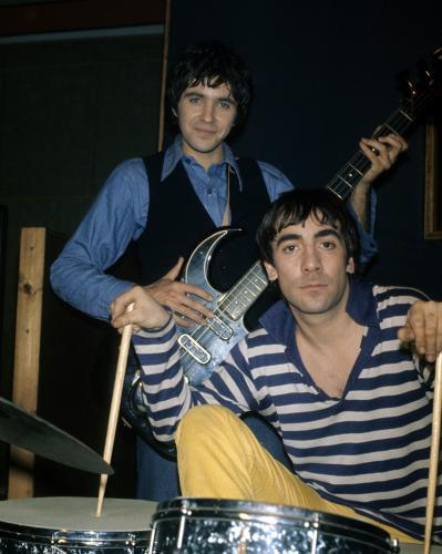 Keith Moon poses with David Essex during the shooting of the film 'Stardust' in June 1974 in London