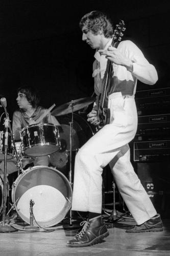 Pete Townsend performing live on stage with The Who in Detroit.