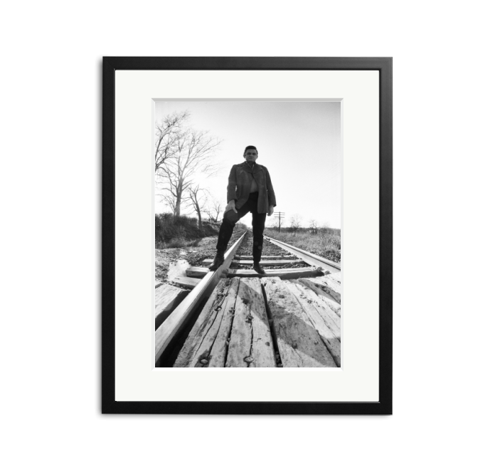 Johnny Cash on railroad tracks | Sonic Editions
